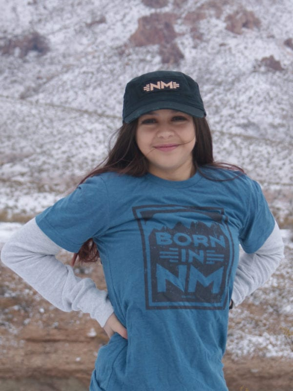 Born in NM